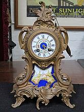 FRENCH STYLE GILT METAL MANTEL CLOCK WITH HANDPAINTED PORCELAIN DIAL AND PANEL, APPROXIMATELY 37cm HIGH