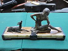 ART DECO BRONZE STYLE FIGURE GROUP DEPICTING A SEATED LADY, ON MARBLE STAND, SIGNED URIANO ET ROCHARD