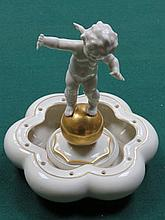 LORENZ HUTSCHEN REUTHER GILDED CERAMIC POSY BOWL WITH CHERUB CENTRE PIECE, STAMPED K TUTTER, APPROXIMATELY 19cm HIGH