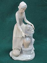 NAO GLAZED CERAMIC FIGURE OF A WATER CARRIER. APPROX 30cm HIGH