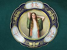 ROYAL VIENNA HANDPAINTED AND GLIDED CERAMIC PLATE SIGNED WAGNER. APPROX 23c