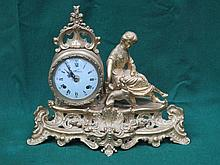 ITALIAN GILT METAL FIGURE FORM MANTLE CLOCK WITH ENAMELLED DIAL. APPROX 31c