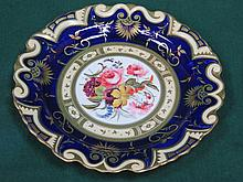 PAIR OF VICTORIAN HANDPAINTED AND GILDED FLORAL DECORATED CERAMIC PLATES. A