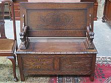 HEAVILY CARVED OAK MONKS BENCH WITH LIFT UP SEAT
