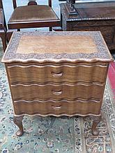 SMALL CHEST OF THREE DRAWERS WITH CARVED DECORATION AND SERPENTINE FRONT