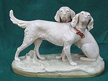 ROYAL DUX BOHEMIA GLAZED CERAMIC FIGURES GROUP DEPICTING TWO DOGS. APPROX 2