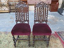 PAIR OF HEAVILY CARVED OAK BARLEY TWIST CHAIRS