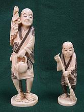 TWO HEAVILY CARVED IVORY ORIENTAL GENTLEMAN