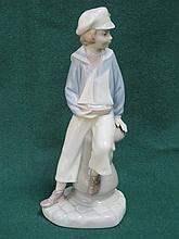 LLADRO GLAZED CERAMIC FIGURE OF A SEATED BOY WITH BOAT. APPROX 23cm HIGH