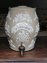19th CENTURY GLAZED STONEWARE SPIRIT BARREL DECORATED WITH VINES, RECUMBENT