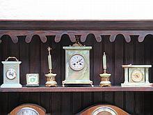 THREE VARIOUS ONYX STYLE MANTEL CLOCKS AND FOLDING TRAVEL CLOCK