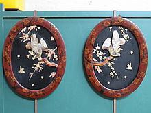 PAIR OF ORIENTAL LACQUERED, HANDPAINTED AND RELIEF DECORATED OVAL PANELS, A