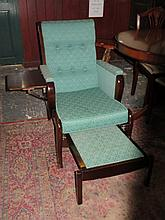 OAK AND MAHOGANY FRAMED UPHOLSTERED ARMCHAIR WITH PULL OUT FOOT STOOL AND L