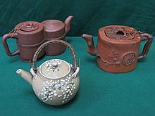 TWO UNGLAZED ORIENTAL TEAPOTS, ONE WITH RELIEF DECORATION, ALSO SMALL GLAZE