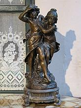 VICTORIAN BRONZE EFFECT FIGURE GROUP OF A BOY AND GIRL ON CAST METALS STAND