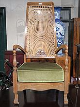 OAK BERGERE HIGH BACKED LOW SEATED ARMCHAIR