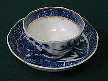 SALOPIAN POTTERY BLUE AND WHITE CERAMIC TEA BOWL AND SAUCER