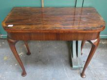 ANTIQUE MAHOGANY FOLD OVER CARD TABLE ON CABRIOLE