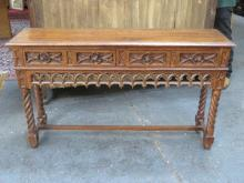 HEAVILY CARVED OAK FOUR DRAWER CONSOLE TABLE