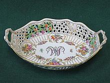 DRESDEN HANDPAINTED AND GILDED FLORAL DECORATED TWO HANDLED PIERCEWORK OVAL