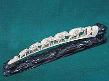 HEAVILY CARVED IVORY ELEPHANT BRIDGE WITH MOTHER OF PEARL DECORATION ON CAR