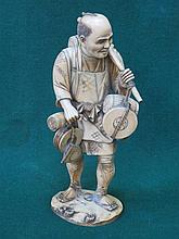 GOOD QUALITY HEAVILY CARVED SECTIONAL IVORY FIGURE DEPICTING AN ORIENTAL GE