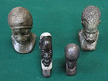 FOUR VARIOUS CARVED STONEWARE AFRICAN STYLE BUSTS