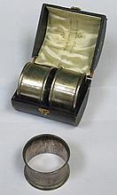 CASED PAIR OF HALLMARKED SILVER NAPKIN RINGS AND ONE OTHER SILVER NAPKIN RING
