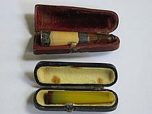 CASED SILVER MOUNTED CHEROOT HOLDER PLUS ONE OTHER