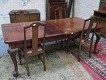 LARGE MAHOGANY WIND OUT TABLE WITH TWO LEAVES ON BALL AND CLAW SUPPORTS PLUS FOUR MAHOGANY DINING CHAIRS