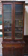 ANTIQUE MAHOGANY GEORGIAN STYLE TWO DOOR GLAZED BOOKCASE WITH CAMPAIGN STYLE BRASS HANDLES