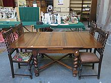 LARGE OAK DRAW LEAF DINING TABLE ON BARLEY TWIST SUPPORTS AND FOUR BARLEY TWIST OAK HIGH BACK CHAIRS