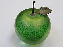 JOHN DITCHFIELD GLASFORM IRIDESCENT GLASS APPLE FORM PAPERWEIGHT WITH HALLMARKED SILVER STORK AND LEAF, SIGNED TO BASE GLASFORM J. DITCHFIELD WITH FOIL LABEL, APPROXIMATELY 10cm HIGH