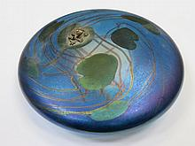 JOHN DITCHFIELD GLASFORM IRIDESCENT GLASS PAPERWEIGHT IN THE FORM OF A LILY PAD WITH A SILVER COLOURED FROG TO TOP, SIGNED TO BASE GLASFORM J. DITCHFIELD WITH FOIL LABEL, DIAMETER APPROXIMATELY 13cm