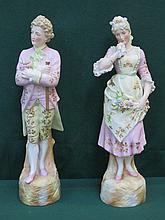 PAIR OF UNGLAZED CONTINENTAL STYLE HANDPAINTED CERAMIC BISQUE FIGURES, APPROXIMATELY 49cm HIGH