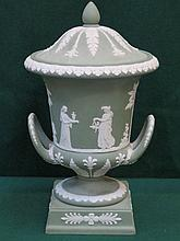 WEDGWOOD GREEN JASPERWARE TWO HANDLED URN WITH COVER, APPROXIMATELY 30cm HIGH