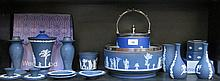 PARCEL OF APPROXIMATELY SEVENTEEN PIECES OF WEDGWOOD, MAINLY DARK BLUE JASPERWARE INCLUDING BISCUIT BARREL WITH PLATE COVER AND HANDLE, SALAD BOWL WITH PLATED RIM, ETC.