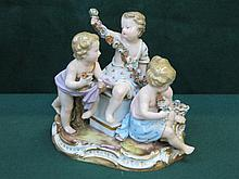 MEISSEN HANDPAINTED AND GILDED RELIEF DECORATED FIGURE GROUP, APPROXIMATELY 17cm HIGH