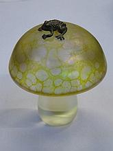 JOHN DITCHFIELD GLASFORM IRIDESCENT GLASS MUSHROOM FORM PAPERWEIGHT WITH SILVER COLOURED FROG TO TOP, INITIALLED J.D. WITH FOIL LABEL, APPROXIMATELY 7.5cm HIGH
