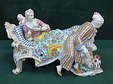 MEISSEN STYLE HANDPAINTED AND GILDED FIGURE GROUP, BLUE CROSS MARKS TO BASE
