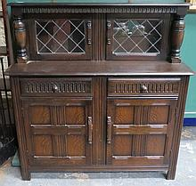 OAK LINEN FOLD FRONTED COURT CUPBOARD WITH LEAD GLASS DOORS