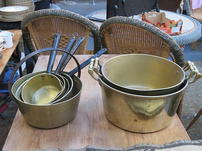 TWO BRASS TWO HANDLED PANS, BRASS JAM PAN AND GRADUATED SAUCEPANS