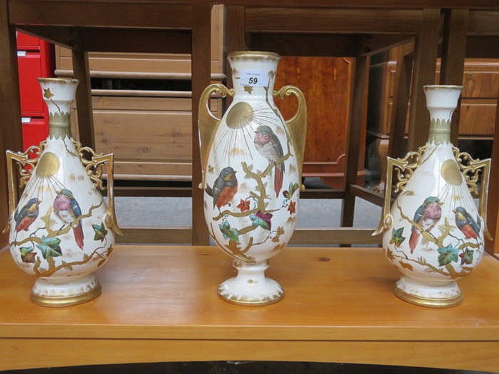 PAIR OF HANDPAINTED AND GILDED TWO HANDLED VASES PLUS ANOTHER SIMILAR VASE,