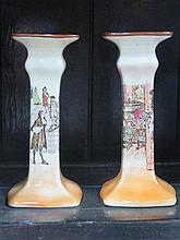 PAIR OF ROYAL DOULTON GLAZED CERAMIC CANDLESTICKS DEPICTING CLASSICAL SCENES