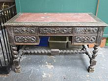 HEAVILY CARVED OAK BARLEY TWIST FIVE DRAWER WRITING DESK WITH RED LEATHER I