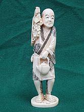 HEAVILY CARVED IVORY FIGURE OF AN ORIENTAL GENTLEMAN, APPROXIMATELY 16cm HI