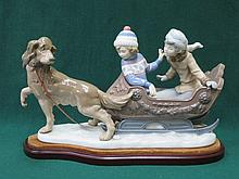 LLADRO GLAZED CERAMIC FIGURE GROUP - SLEIGH RIDE ON WOODEN PLINTH 30cm