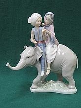 LLADRO GLAZED CERAMIC FIGURE GROUP OF BOY AND GIRL RIDING AN ELEPHANT 24cm