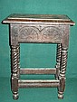 SMALL CARVED OAK STOOL WITH HINGED TOP ON BARLEY