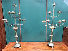 PAIR OF EIGHT SCONCE BRASS CANDELABRAS.